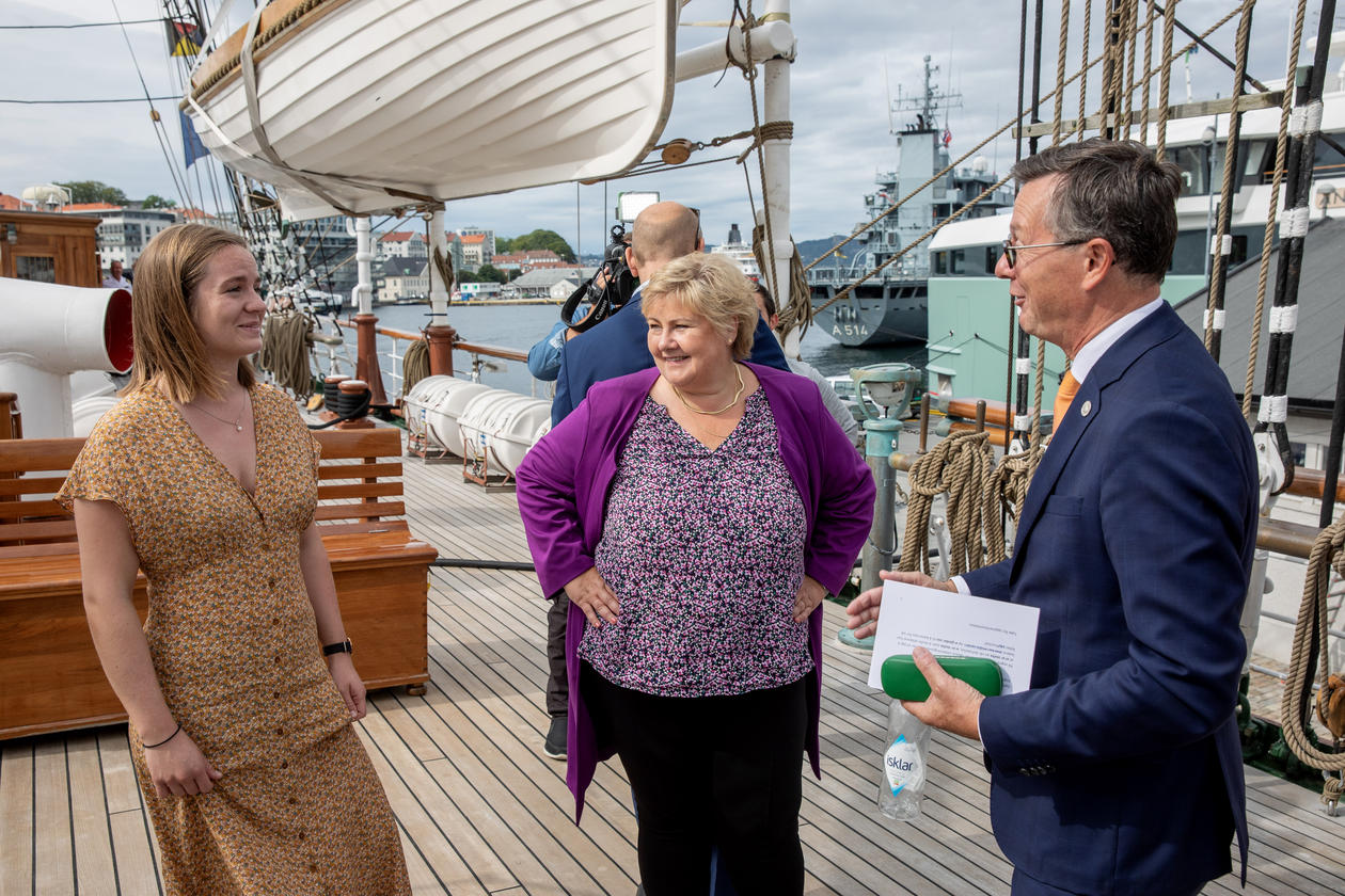 Student Thea Båtevik and Rector Dag Rune Olsen from the University of Bergen with Norway's Prime Minister Erna Solberg at the launch of the One Ocean Expedition on board tall ship Statsraad Lehmkuhl.