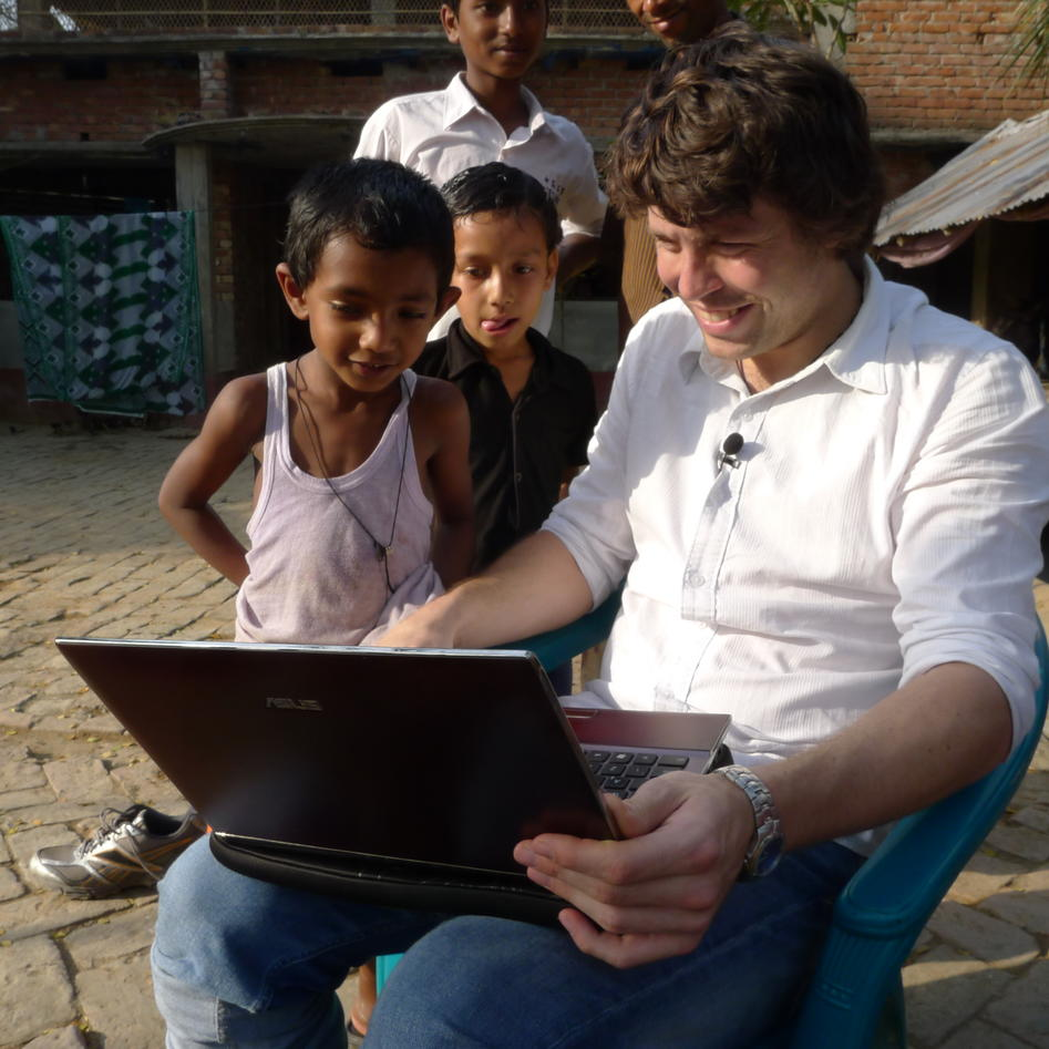 UiB researcher Researcher Scott Bremer with local children on a visit to the Khulna region in March 2012 during field work for an ethical seafood project.