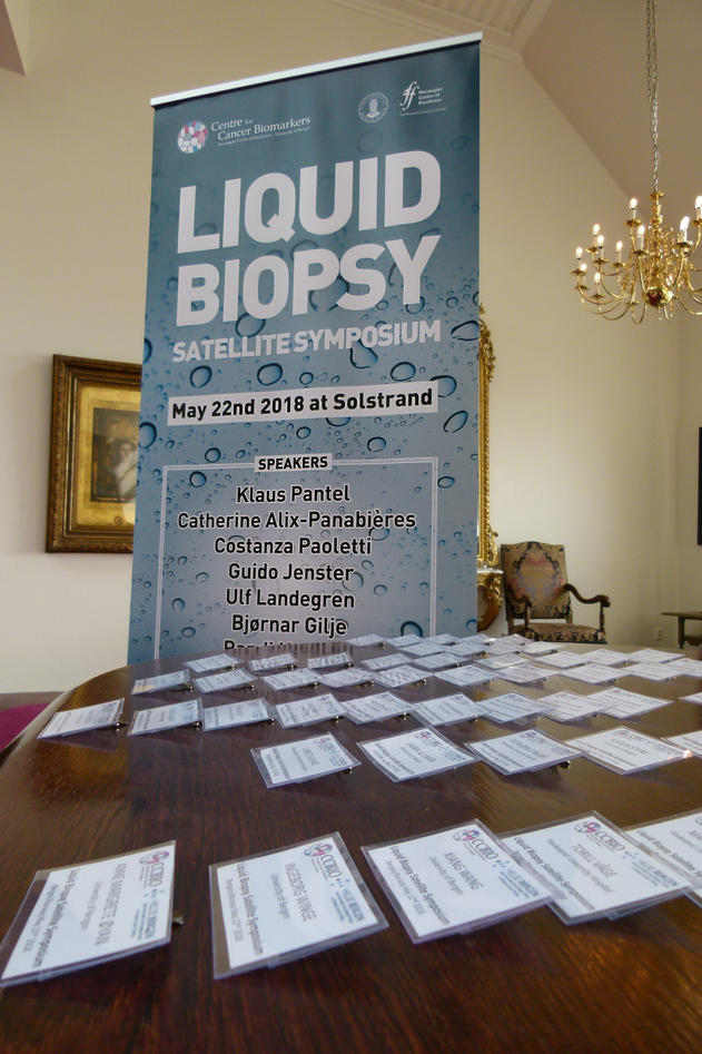 Liquid biopsy banner, and name tags.