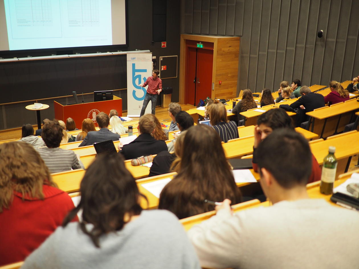 Students in auditorium with presenter in background