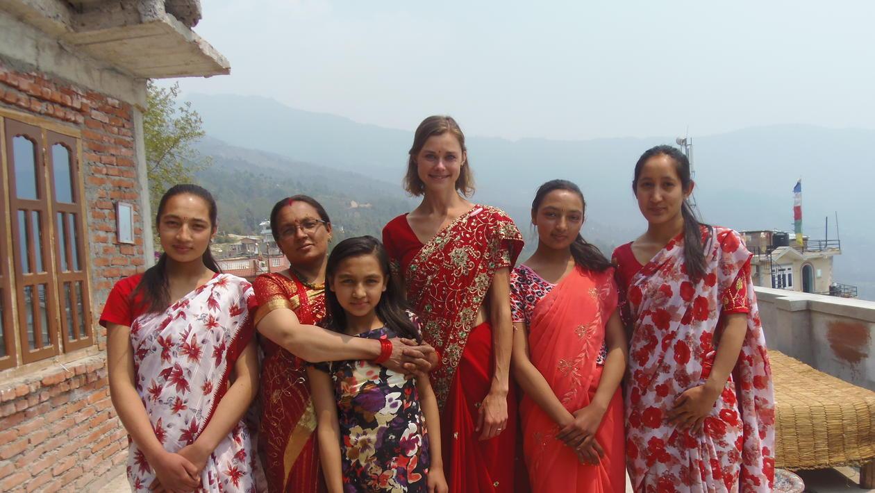 Nina in sari with women in Nepal.