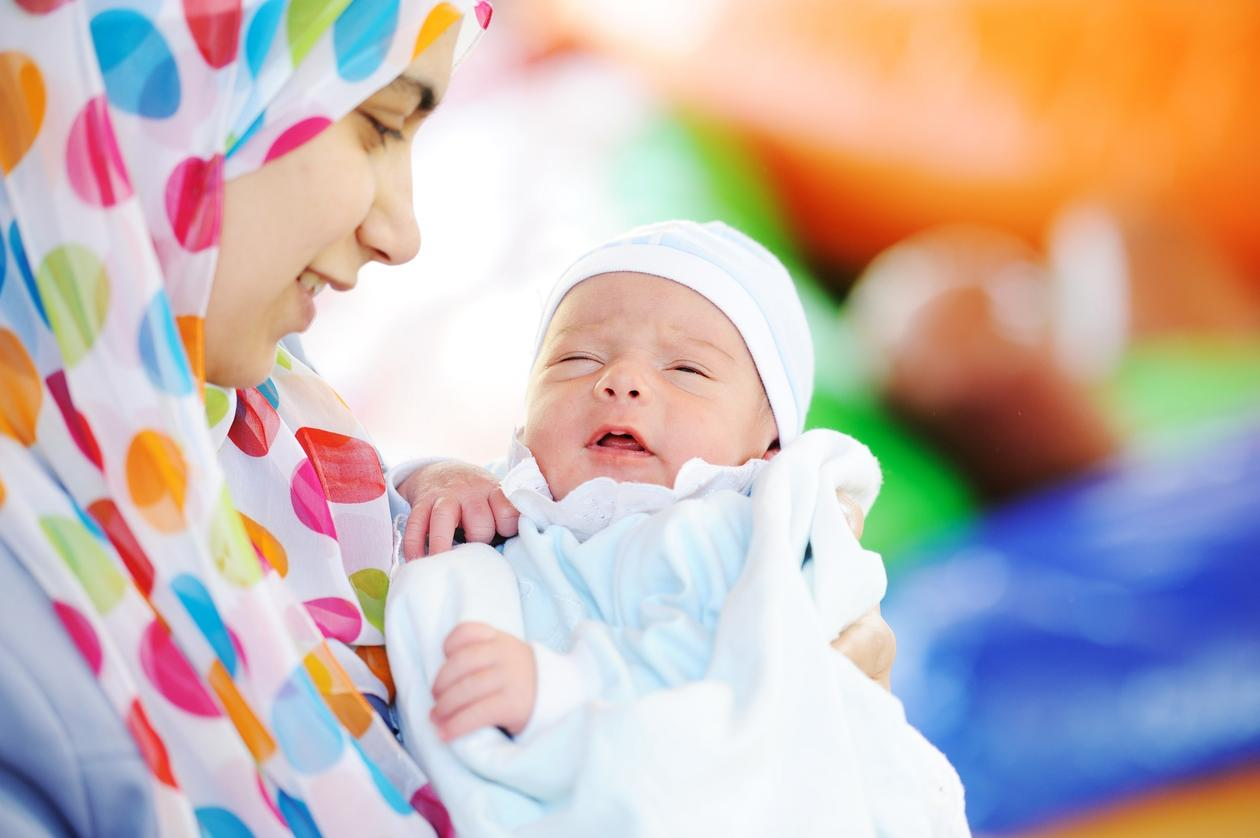 Mother with baby on a Palestinian health centre, Palestine, NIPH