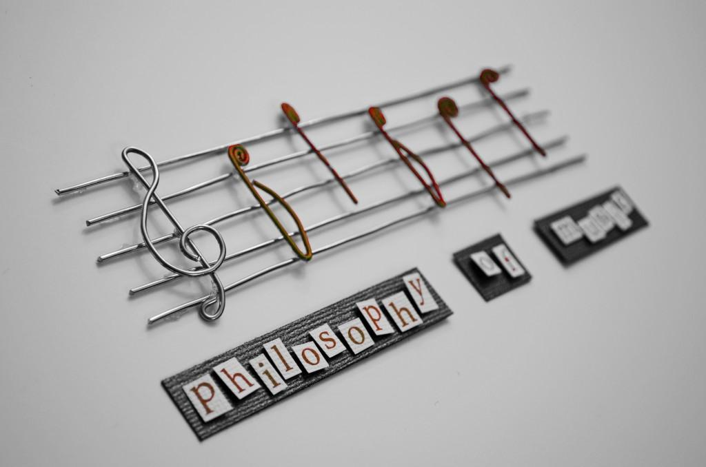 "En notelinje med teksten ""Philosophy of music"" under."