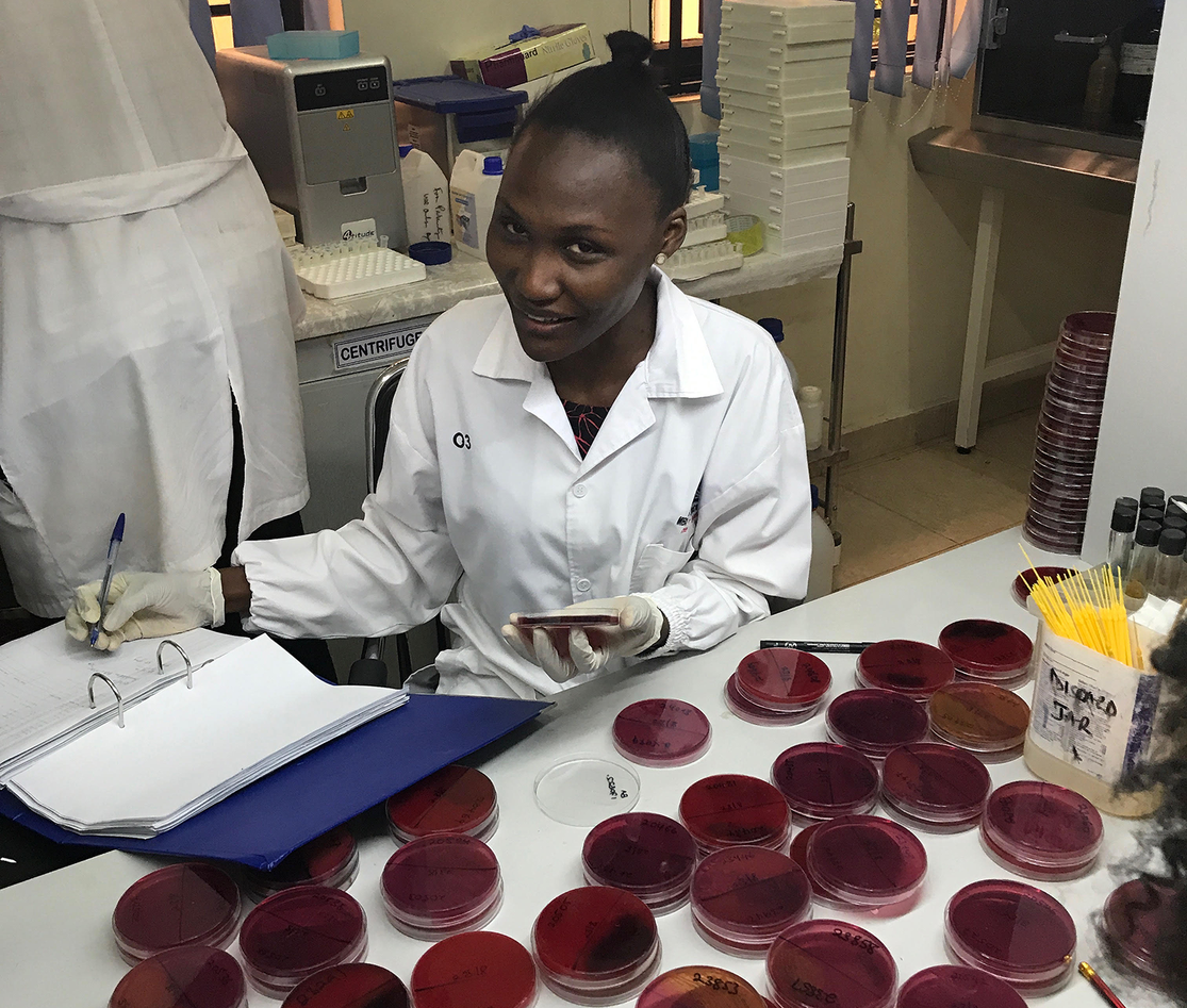 Josephine Tumuhamye reading plates