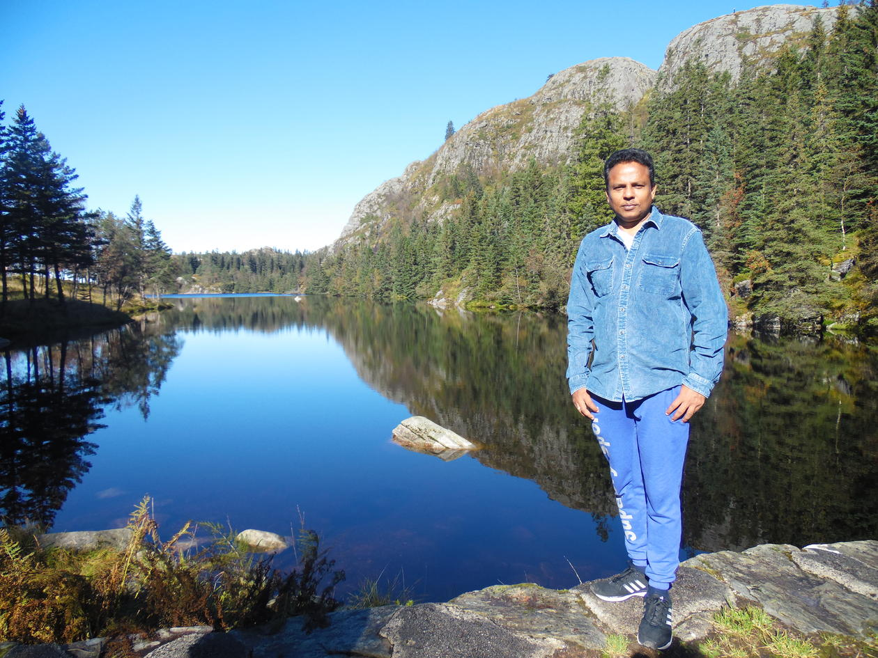 Dr Asela Perera hiking above Bergen