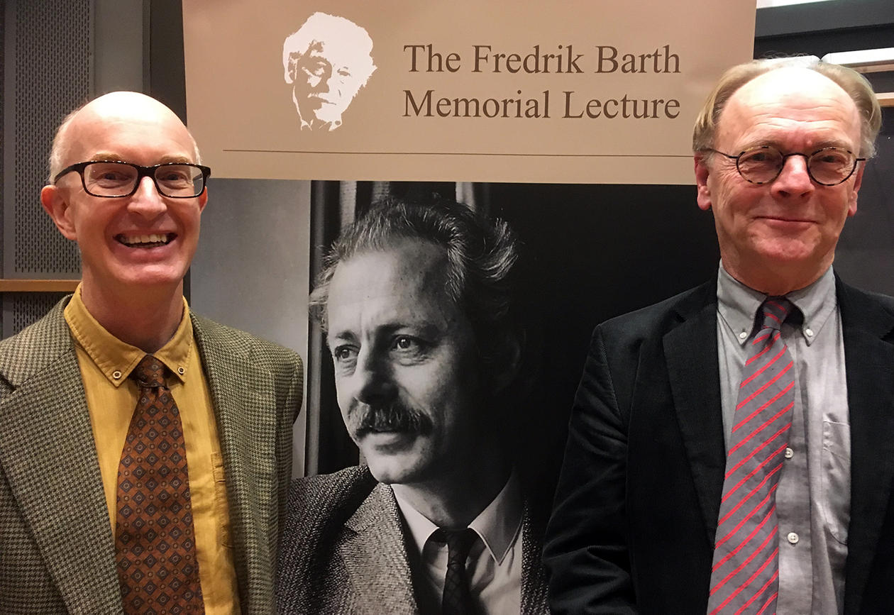 Dr. Scott and Prof. Smedal in front of Fredrik Barth roll-up