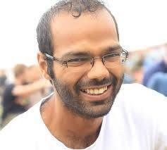 Man with glasses smiling to the camera