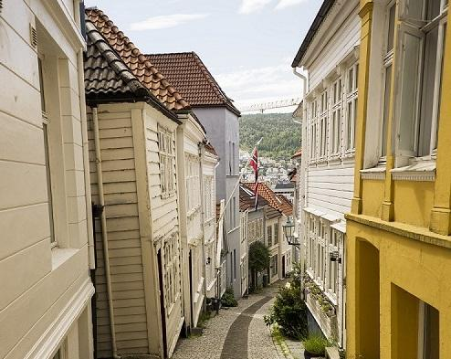 Houses surrounding an old, narrow street