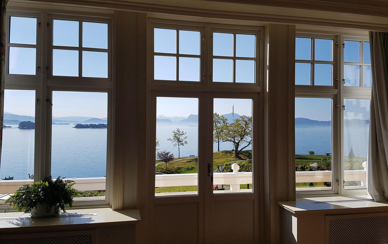 The fjord view through the historical hotel windows.