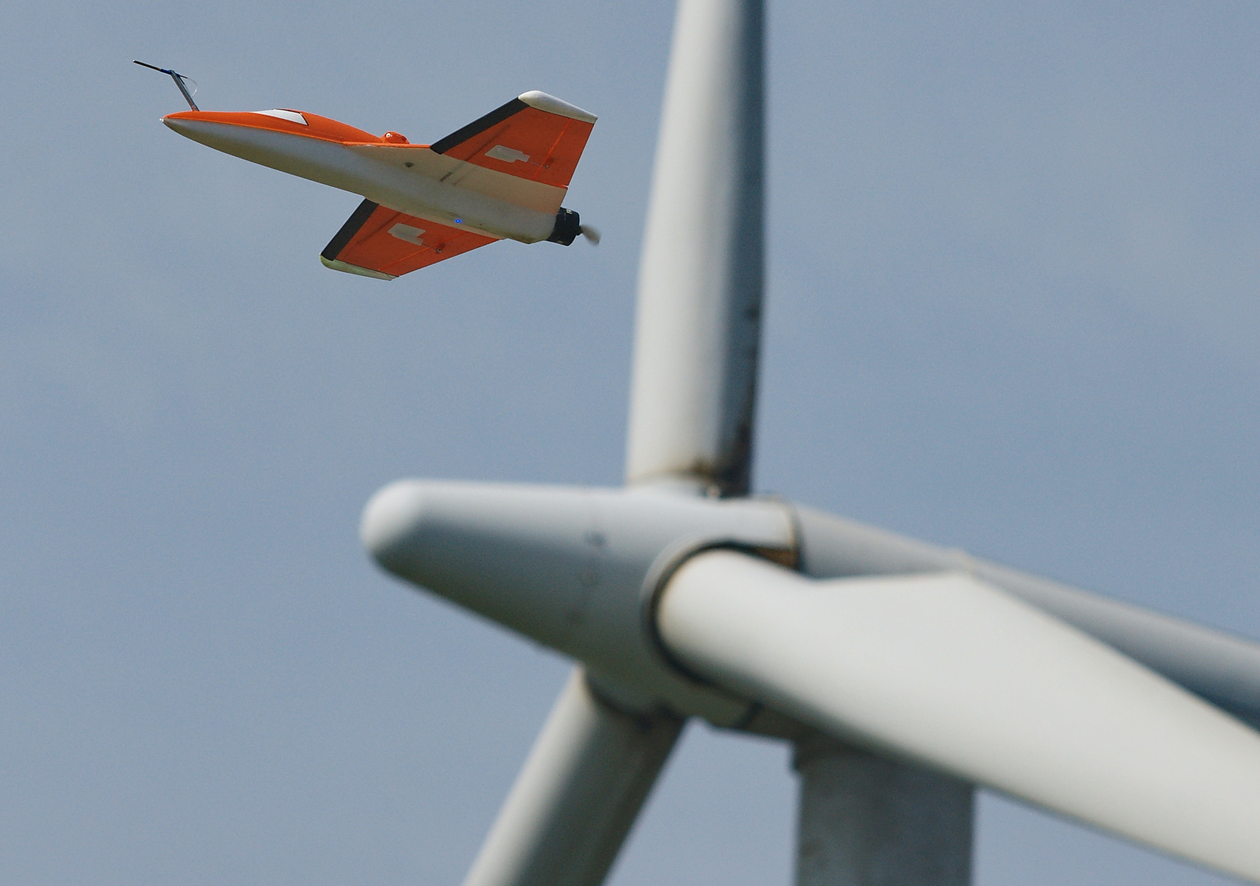 The SUMO unmanned aircraft in front of a wind turbine