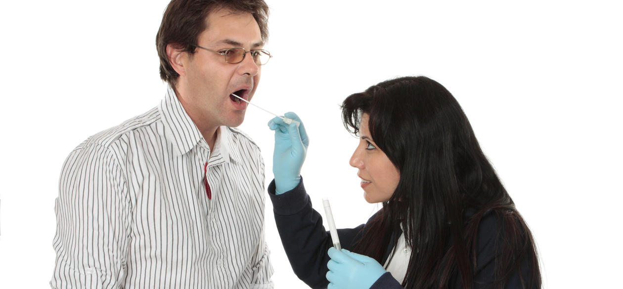 investigator swabs a person in his mouth.