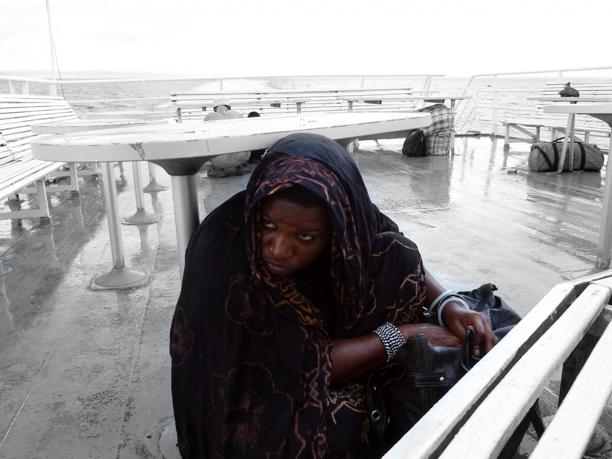 Person on board a ferry between the Tanzanian mainland and the island of Zanzibar in stormy weather.
