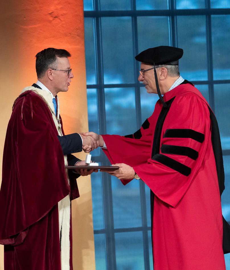 Rector delivering the conferment to Professor Zetter