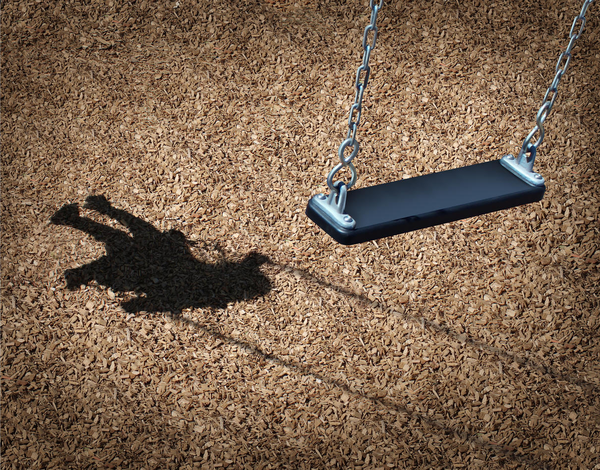 Empty Swing and shadow of a child