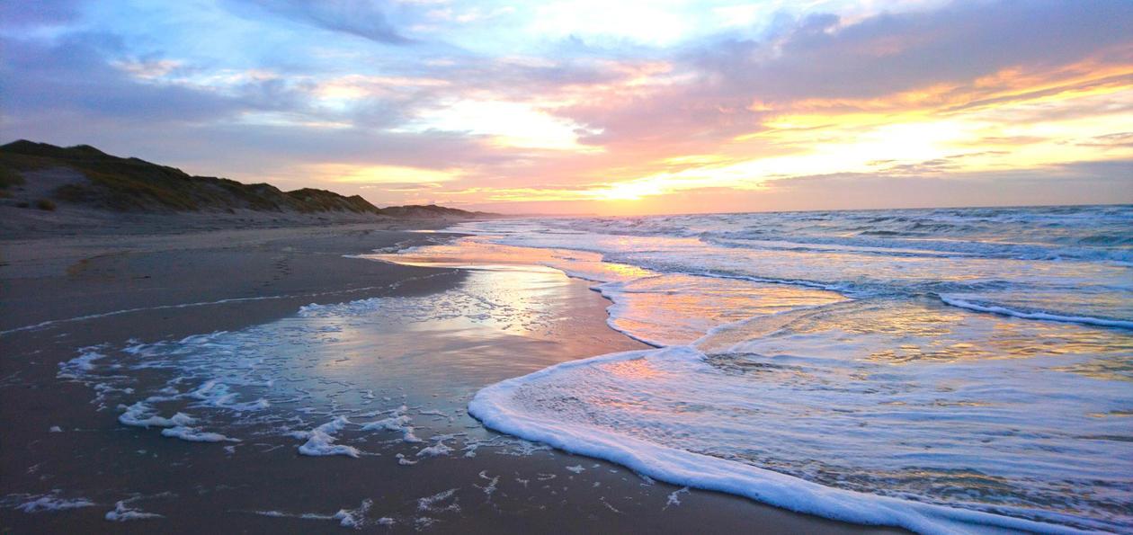 Bilde av solnedgang på stranden