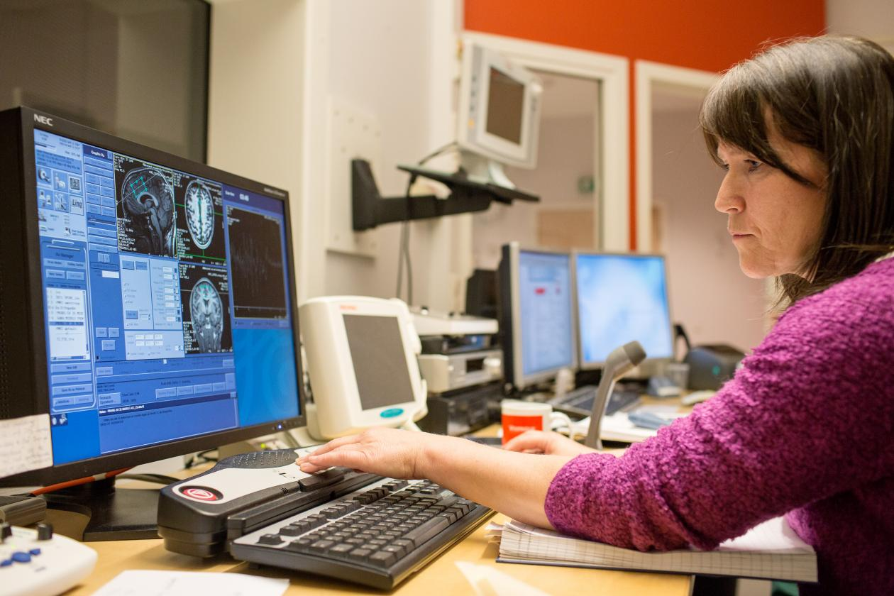 Radiographer Turid Randa records information whilst an Utøya survivor's head is being scanned.