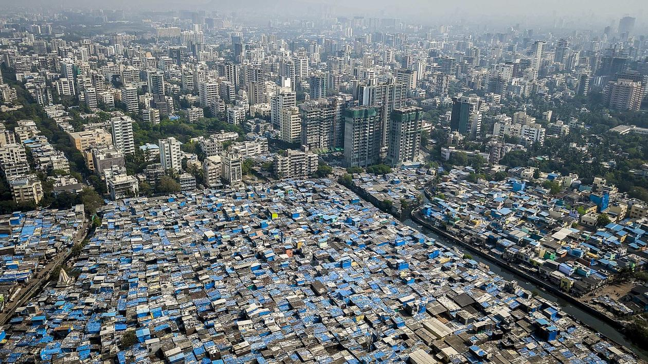 City landscape showing inequality between poor and rich areas in a sprawling metropolis.