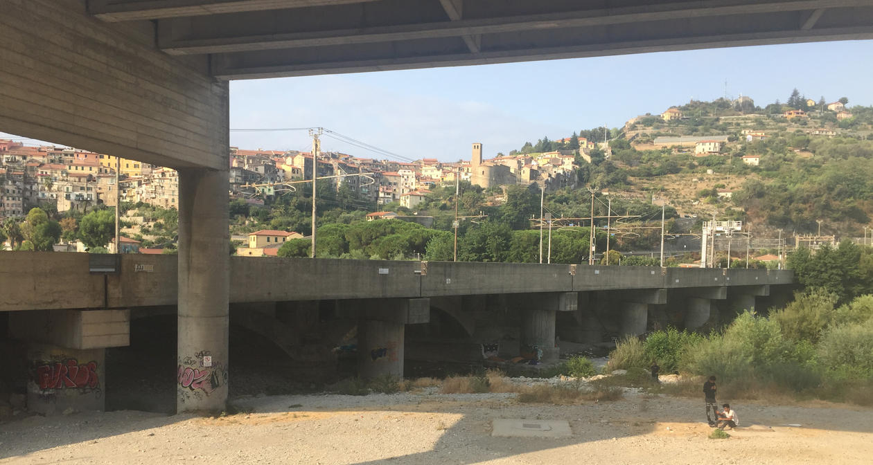 Two irregular migrants under a highway bridge in Vintimiglia