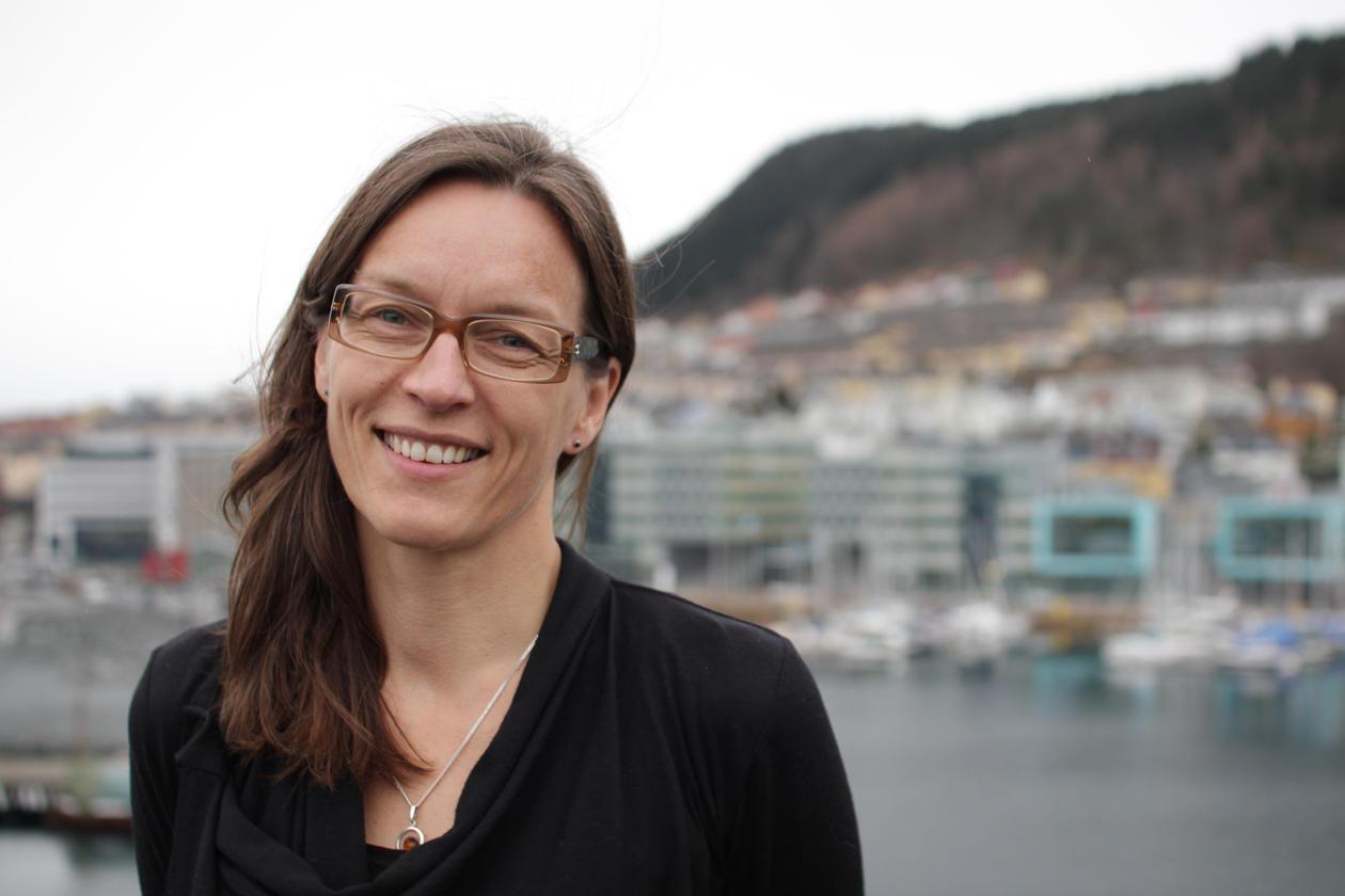 Vigdis Vandvik in front of a back drop of the city of Bergen