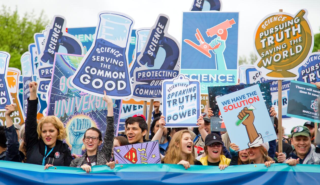 Demonstrators with placards about science
