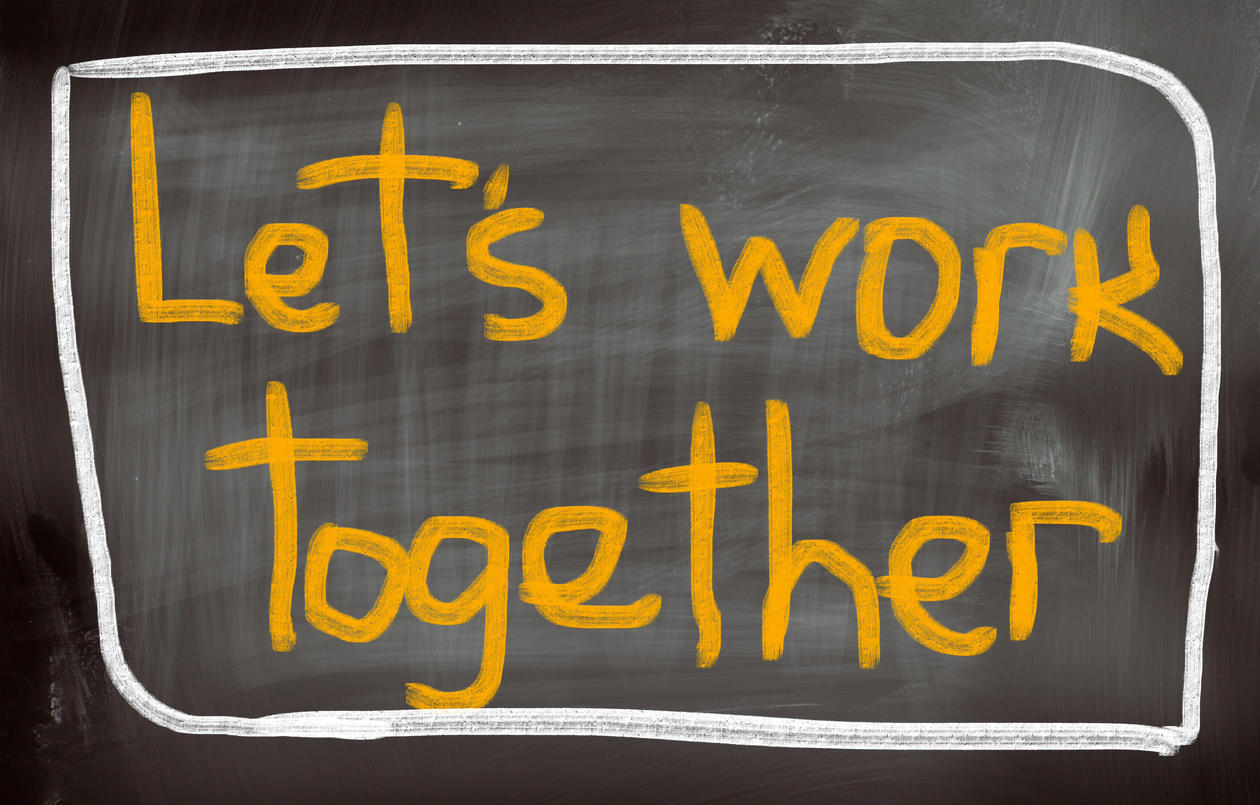 The text 'Let's work together' on a black-board