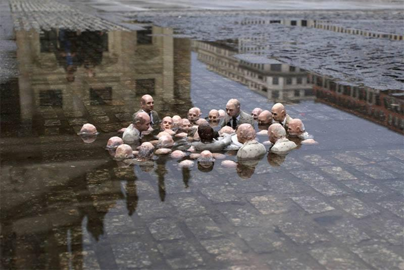 People submerged in water discussing