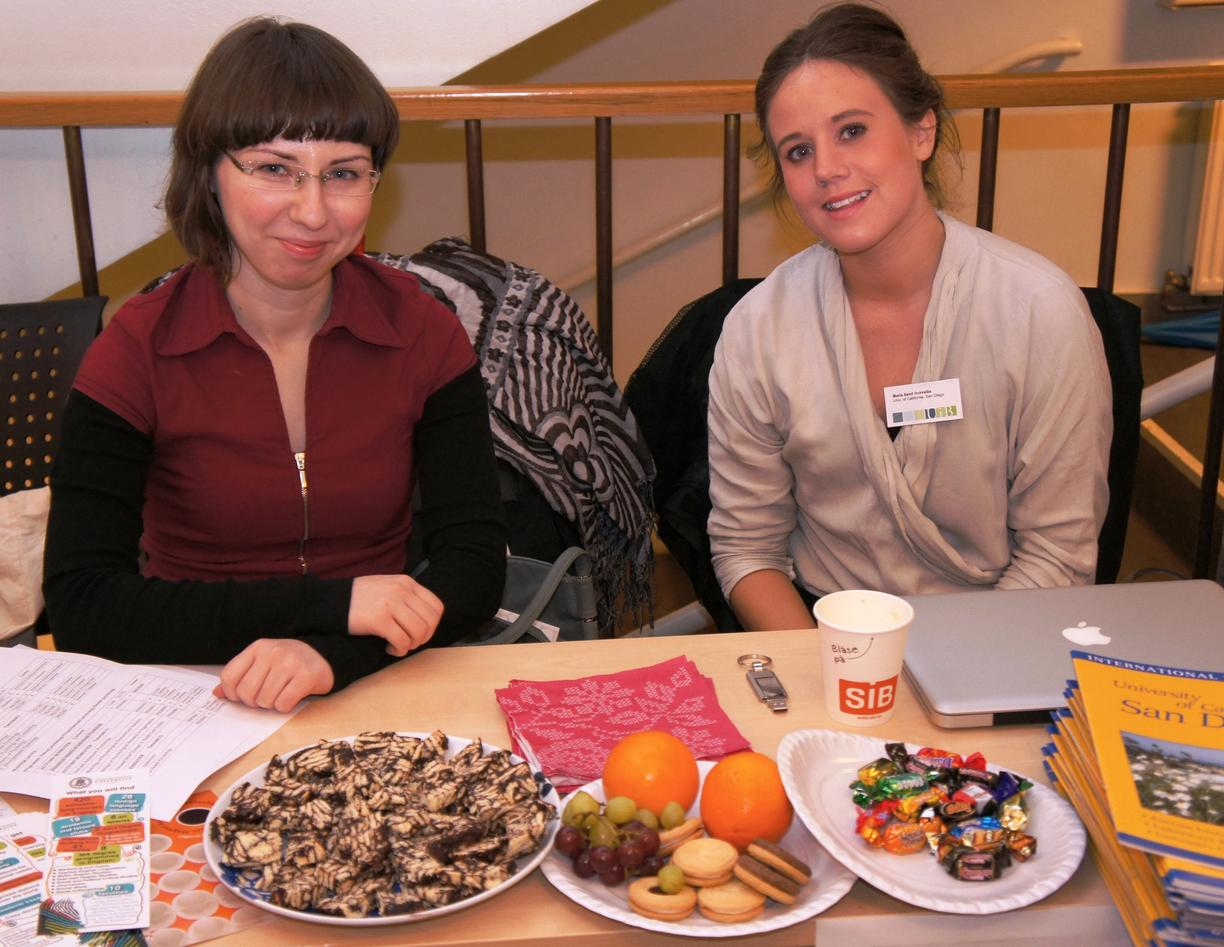 Marina Rogilo from Lithuania and Maria Sand Hukkelås served cake along with...