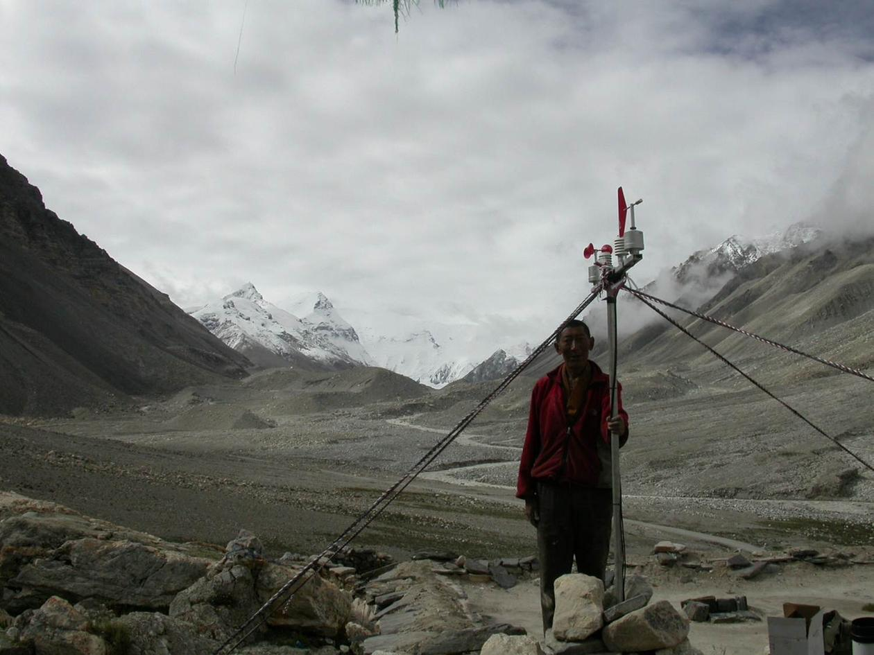 A Monk taking care of the Automatic Weather station raised at Everest base...