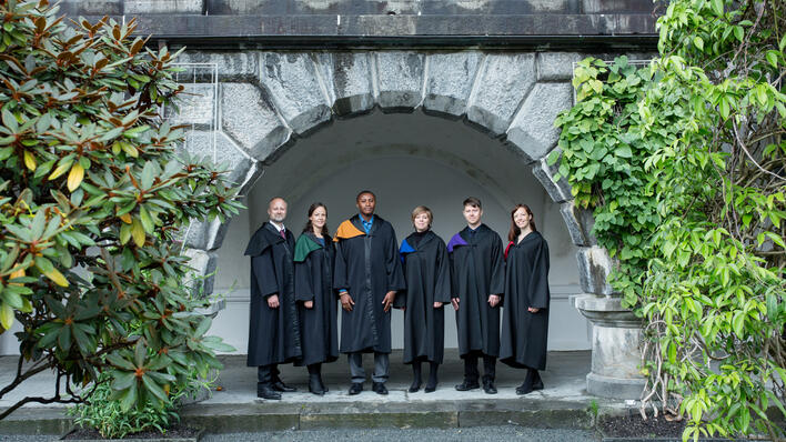 Six Ph.D. candidates in seremonial robes