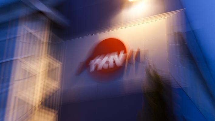 Uskarpt bilde av bygning med NAV-logo