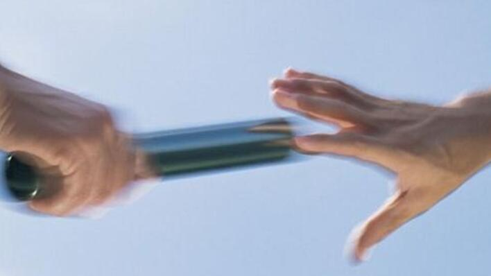 human hands with relay relay baton