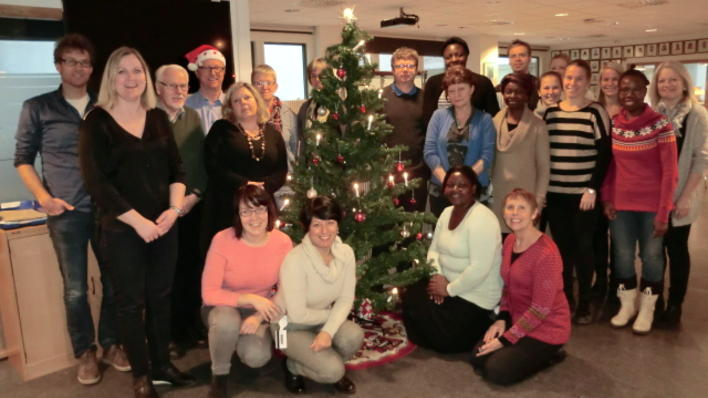 Employees at CIH around a Christmas Tree