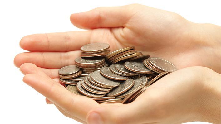 Illustrasjonsbilde: Hånd full av mynter