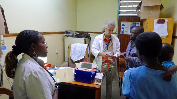 University of Bergen researcher and surgeon Sven Young consulting with assistants and the mother of an infant, who may have broken a bone, at Kamuzu Central Hospital in Lilongwe, Malawi.