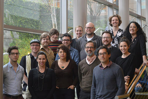 Photograph of 15 researchers standing on stairs at Berkeley