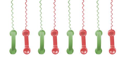 røde og grønne gammeldagse telefonrør som henger ned fra toppen av bildet
