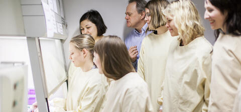 Young researchers in a CCBIO lab supervised by a senior researcher.