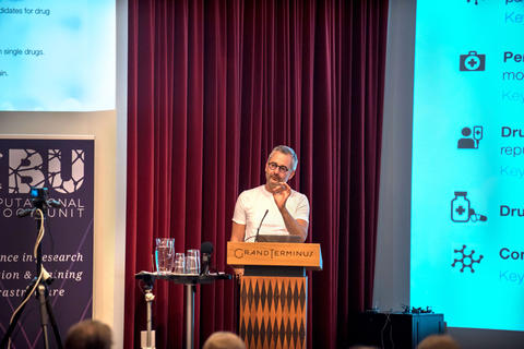 The key lecturer Barabasi on the podium during his speech.