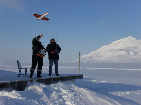 Fig. 3: Operation of the SUMO system on Svalbard. The aircraft is hand...