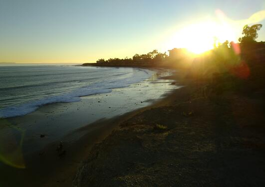 Ocean and coastline with setting sun