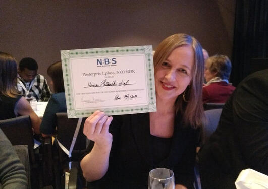 Monica Hellesvik is awarded for best poster at the Norwegian Biochemical Society Meeting 2019