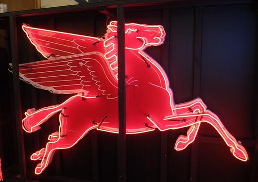 A red neon sign of a pegasus
