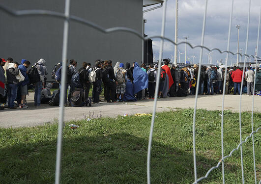 A line of Syrian refugees crossing the border of Hungary and Austria on their way to Germany. Hungary, Central Europe, 6 September 2015