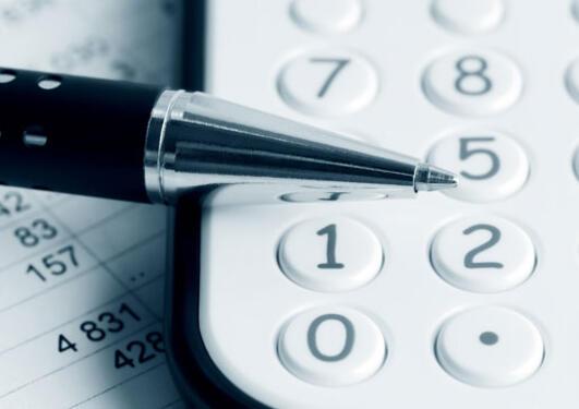 excelsheet, calculator and pen.