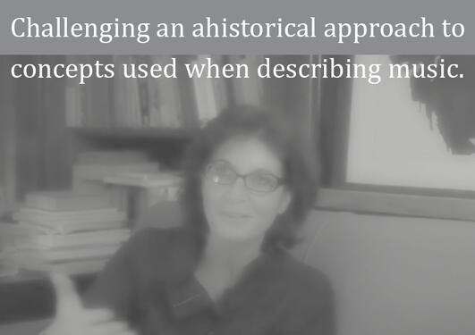 "A blurred photo of Lydia Goehr with the text ""Challenging an ahistorical approach to concepts used when desceibing music."