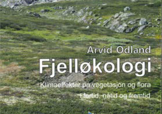 Photo of a Norwegian mountain with snow patches on the front cover of Arvid Odland's book on Fjelløkologi
