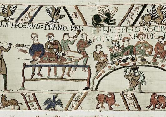 Scene from the Bayeux tapestry showing a medieval feast.