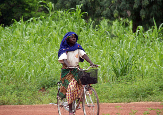 Woman on bicycle, Burkina Faso