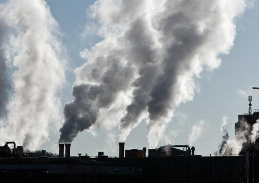 CO2 emissions illustration photo of smoking industrial output