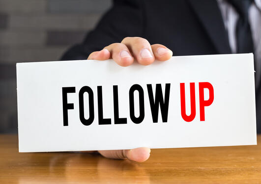 sign with the word follow up
